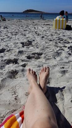 voeten op strand - kanker in zomer